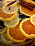 Simmering syrup - remove oranges, lemons & whole spices before dipping cookies!